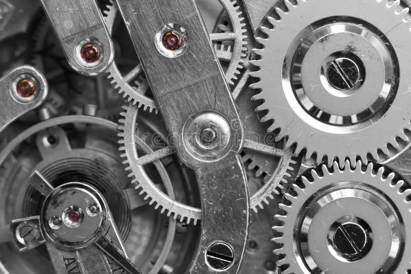 Silver Clockwork. Detail of watch machinery. Old mechanical pocket watch. Macro shot. royalty free stock photography