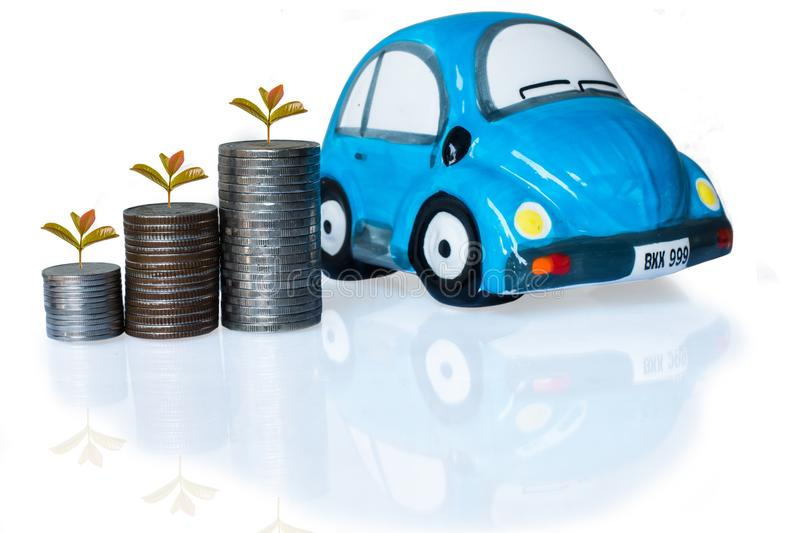 Silver coin and car piggy bank on white background. Saving for car concept royalty free stock photography