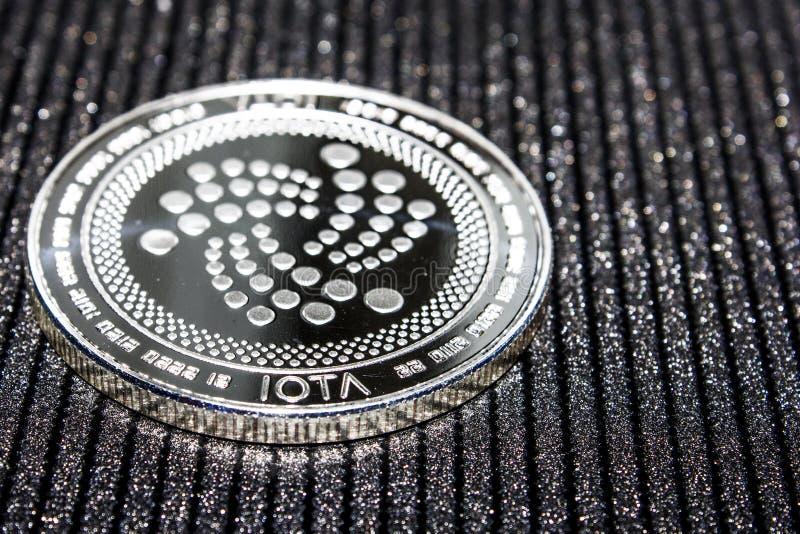 Silver coin cryptocurrency IOTA. MIOTA royalty free stock photo