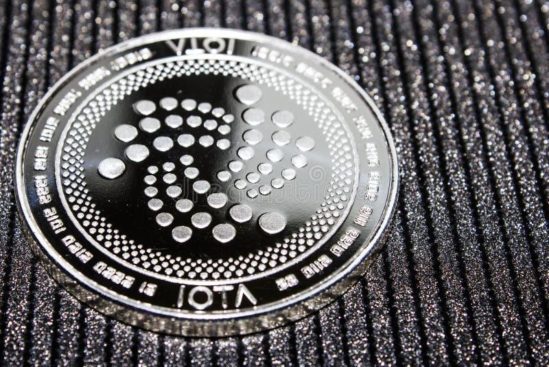 Silver coin cryptocurrency IOTA. MIOTA royalty free stock photos