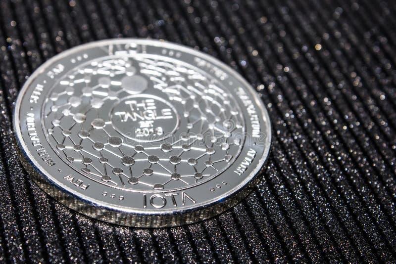 Silver coin cryptocurrency IOTA. MIOTA stock photo