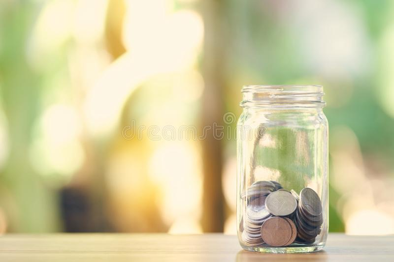 Silver coin in a dozen glasses. Money Saving Media Long-term investment Good money management. as background business concept and royalty free stock photography