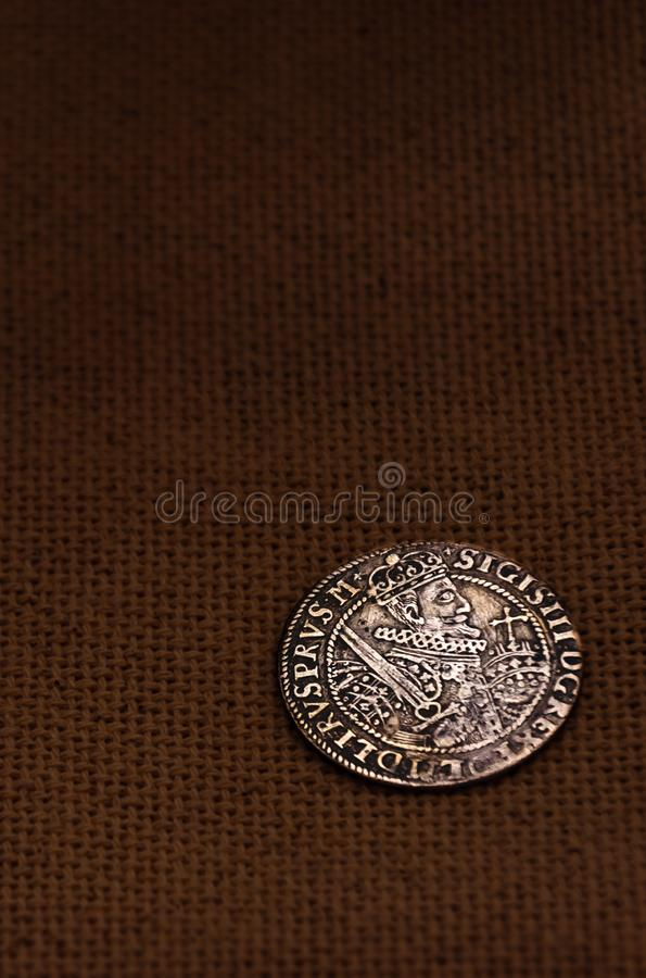 Silver coin on linen background stock image