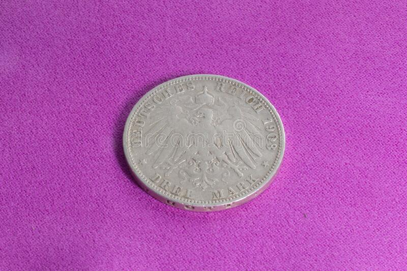 """Silver coin 3 marks. Silver coin of the early 20th century, German Empire, Prussia, 3 marks of 1908, """"Vilgelm II"""". Profile of the emperor on the royalty free stock photos"""