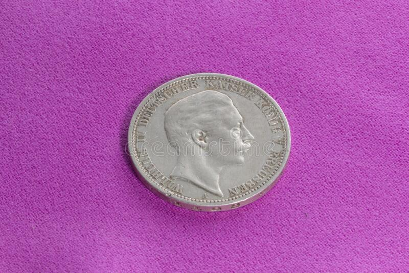 """Silver coin 3 marks. Silver coin of the early 20th century, German Empire, Prussia, 3 marks of 1908, """"Vilgelm II"""". Profile of the emperor on the royalty free stock images"""