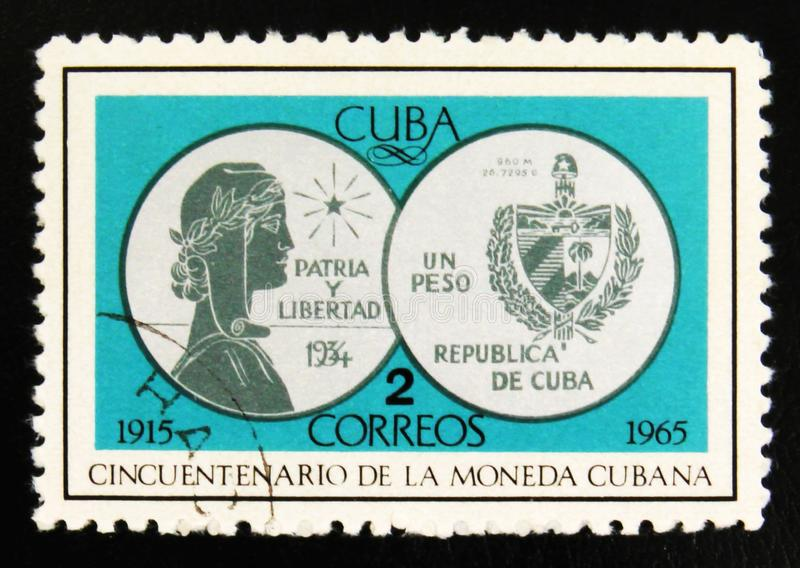 Silver coin One Peso, 1934, 50th Anniversary of Cuban currency, circa 1965. MOSCOW, RUSSIA - JULY 15, 2017: Rare stamp printed in Cuba shows silver coin One Peso royalty free stock photos