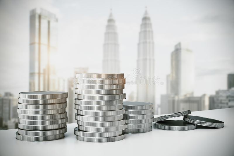 Silver coin piles. Creative silver coin piles on blurry Kuala Lumpur city background. Money and income concept. 3D Rendering royalty free illustration