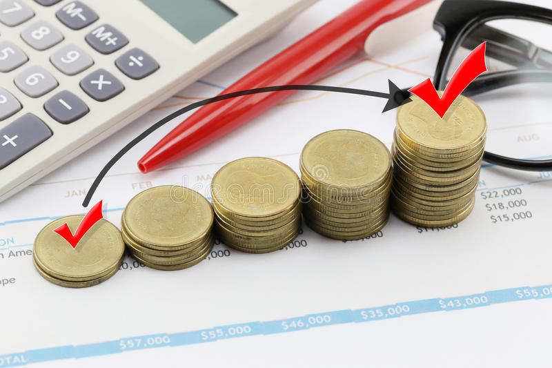Silver coin stack and arrow line and have red check mark in business growth concept. Silver coin stack and arrow line and have red check mark in business growth stock photos