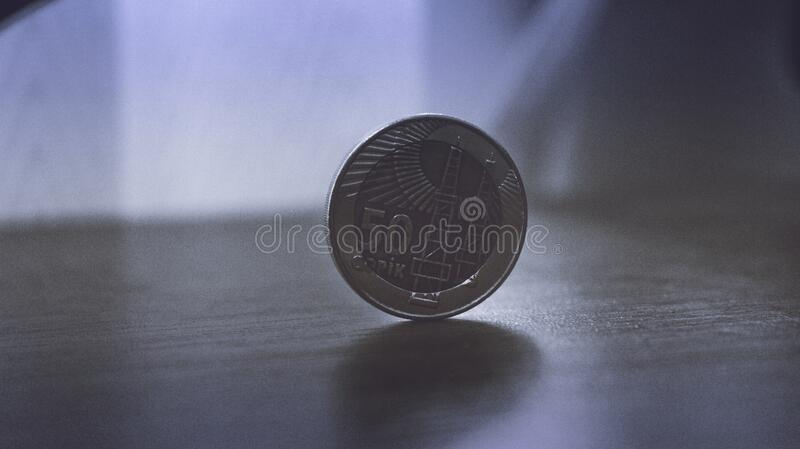 Silver coin on tabletop royalty free stock photo