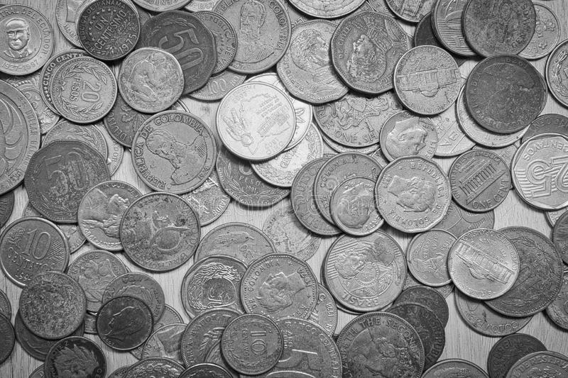 Silver coins from different countries of the world stock photography