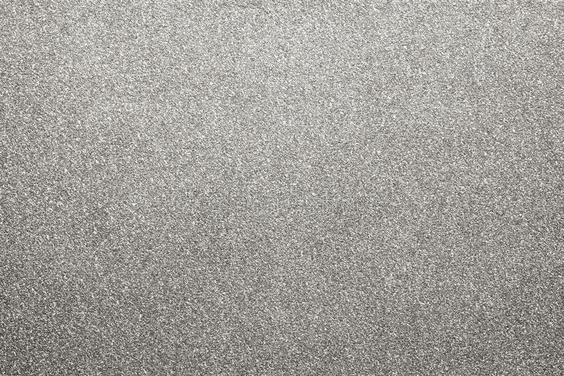 Silver colored glitter paper texture or vintage background royalty free stock photo