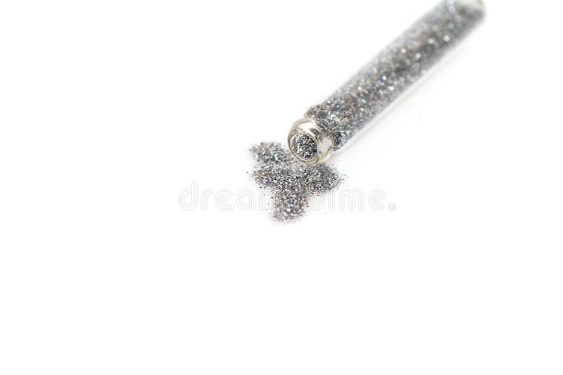 Silver colored glitter in transparent glass jar stock photos