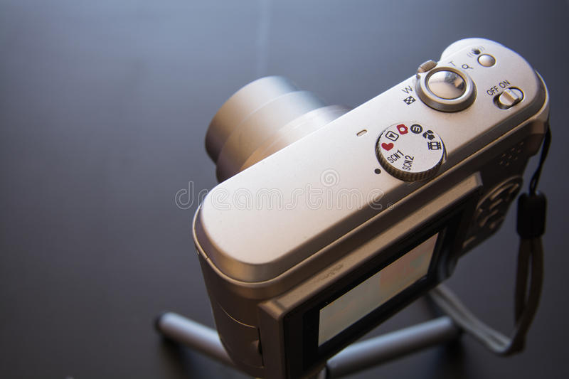 Silver compact digital photo camera. royalty free stock photo