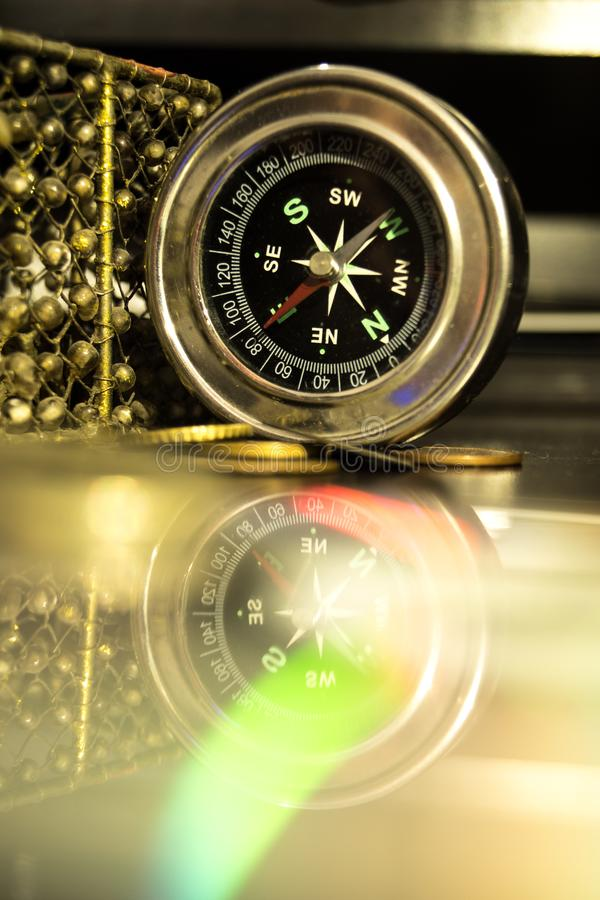 Classy compass and its reflection. royalty free stock photography