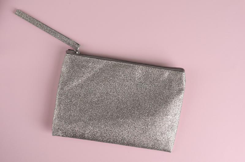 Silver Cosmetic bag on pastel pink background. stock photography
