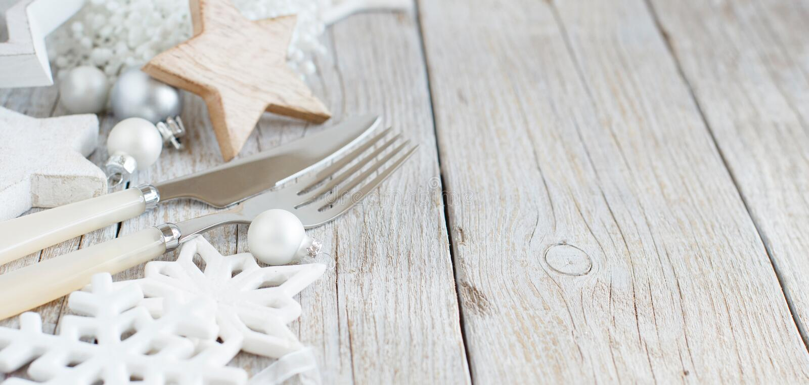 Silver and cream Christmas Table Setting. With christmas decorations stock photos