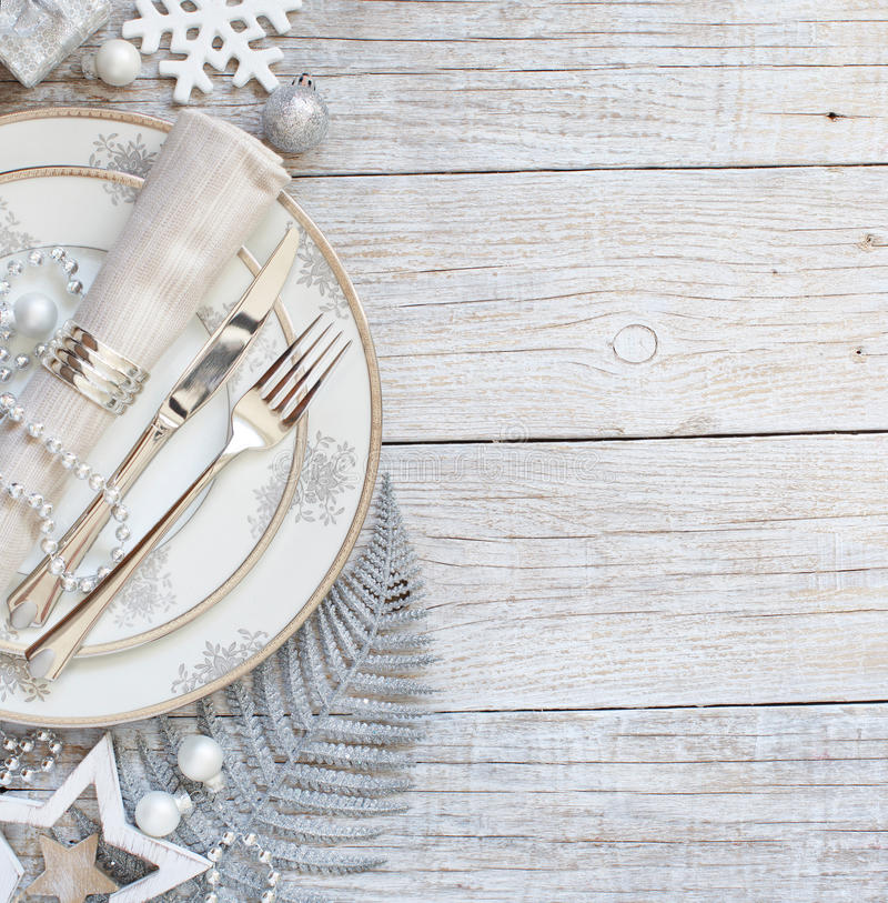 Silver and cream Christmas Table Setting royalty free stock image