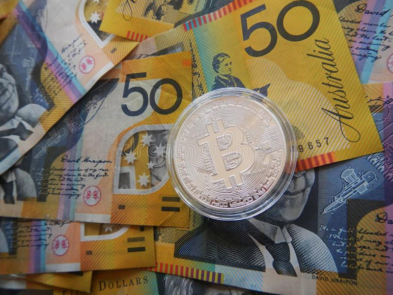 Bitcoin on Australian dollar. Silver cryptocurrency Bitcoin on Australian $50 dollar notes stock photos
