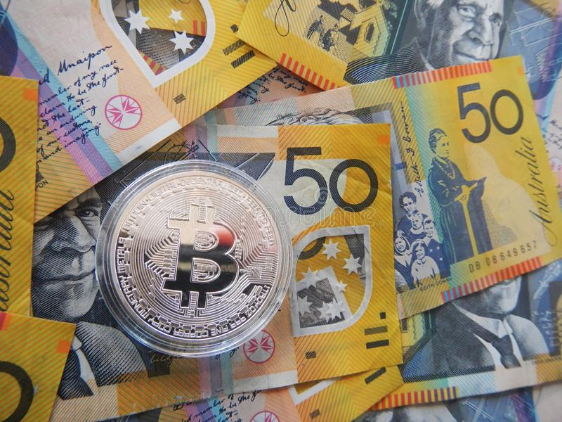 Bitcoin on Australian dollar. Silver cryptocurrency Bitcoin on Australian $50 dollar notes stock photography