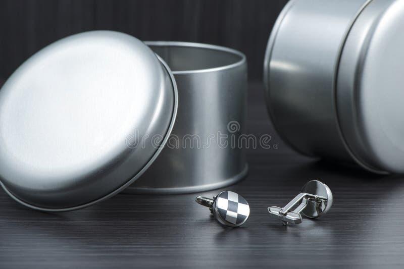 Silver cuff links on black background. Busisnessman royalty free stock photo