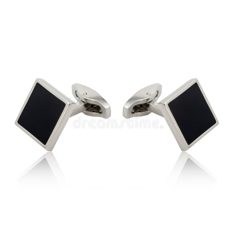 Silver cuff links on white. Background stock image