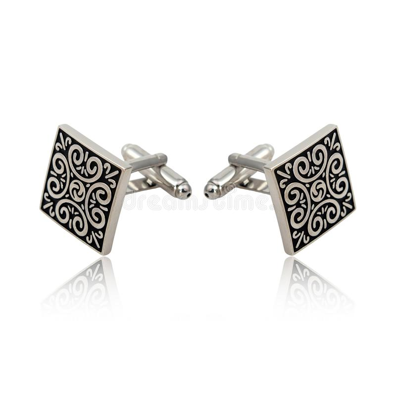 Silver cuff links on white. Background royalty free stock photos
