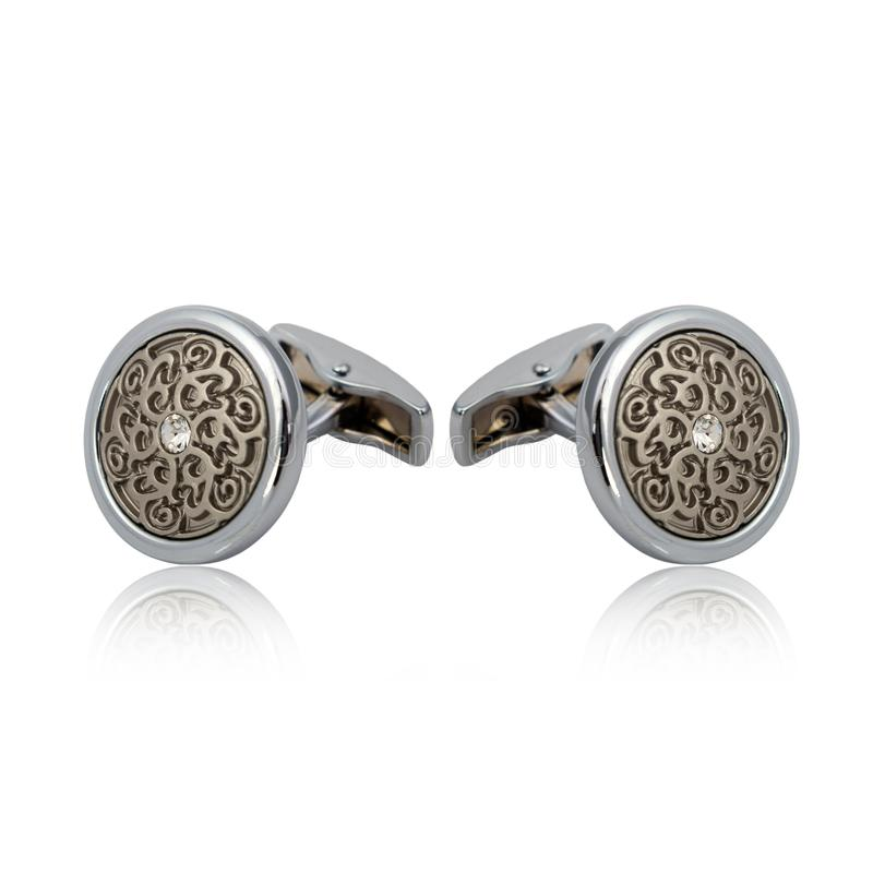 Silver cuff links on white. Background royalty free stock photography