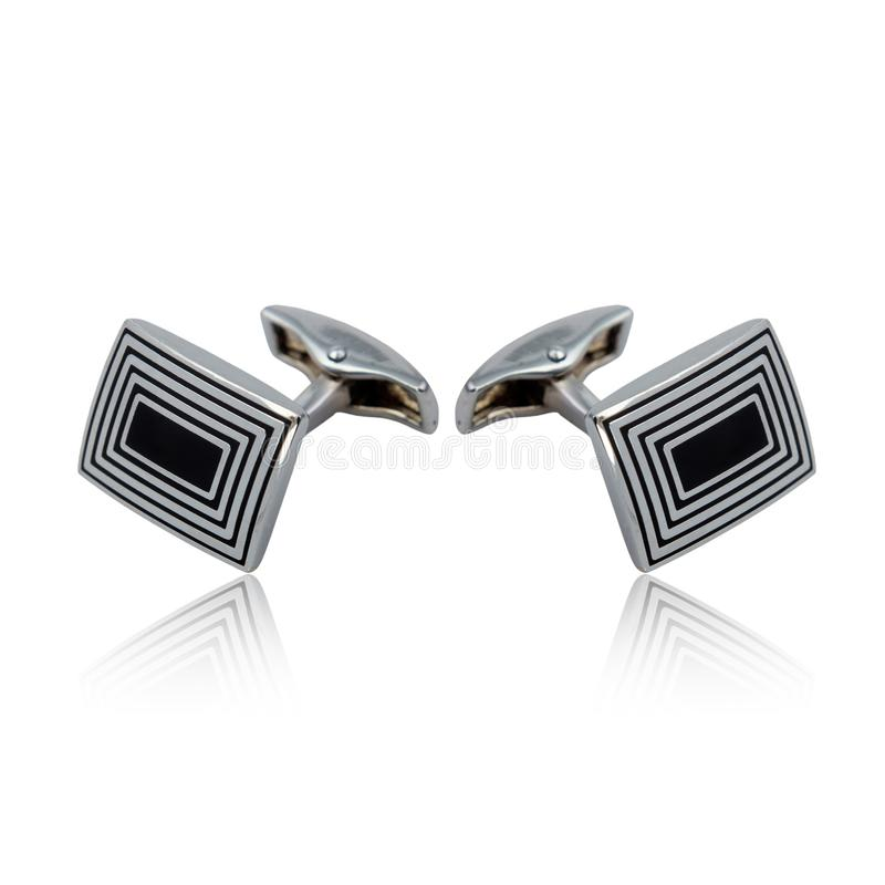 Silver cuff links on white. Background royalty free stock images