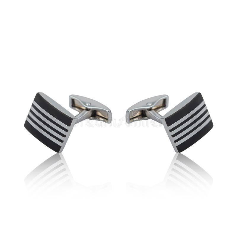 Silver cuff links on white. Background stock photo