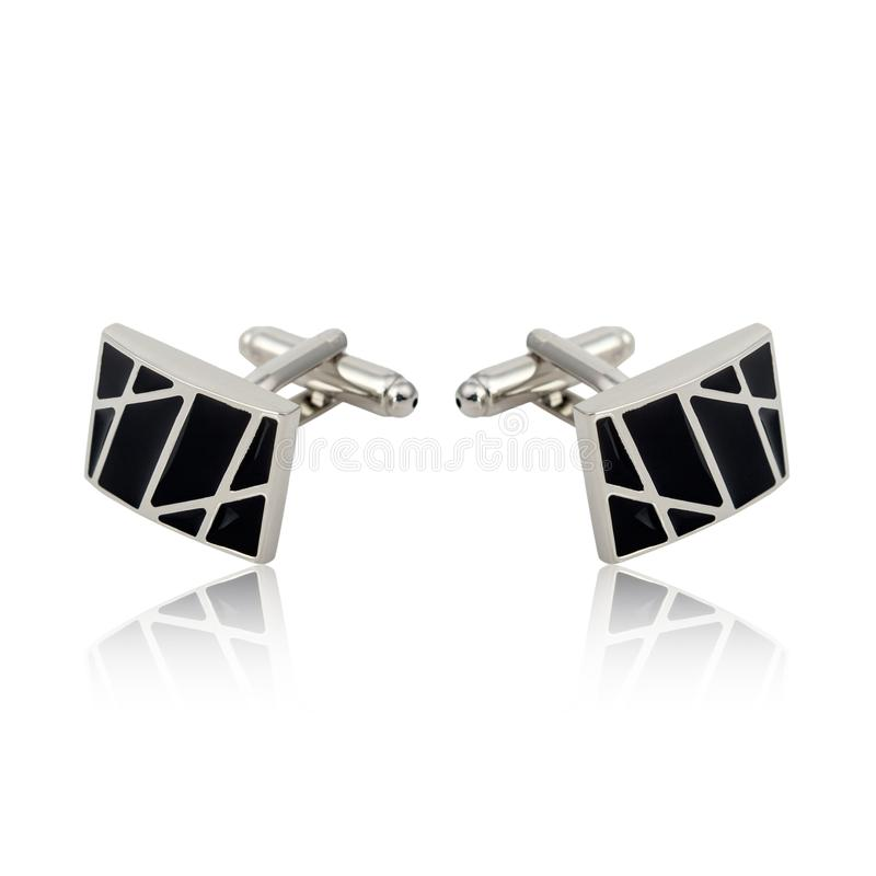 Silver cuff links on white. Background royalty free stock image