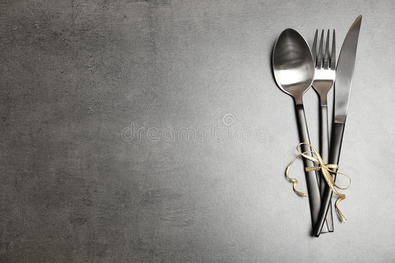 Silver cutlery on gray background, top view stock photo