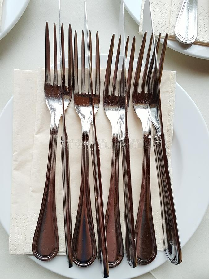 Silver cutlery for luxurious dinner stock photography