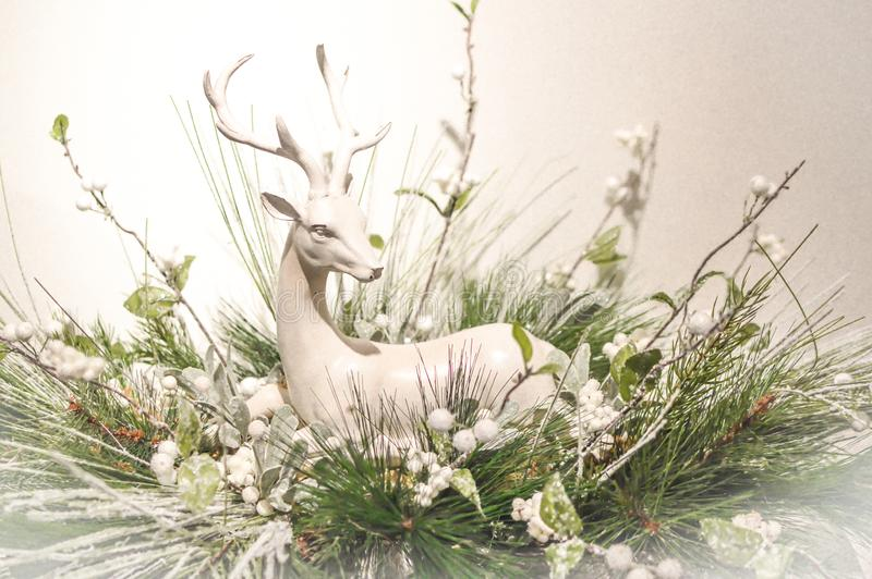 Silver Deer Christmas Mantel Decoration. A silver deer with antlers sitting amidst evergreen branches makes a lovely Christmas mantel decoration or holiday stock images