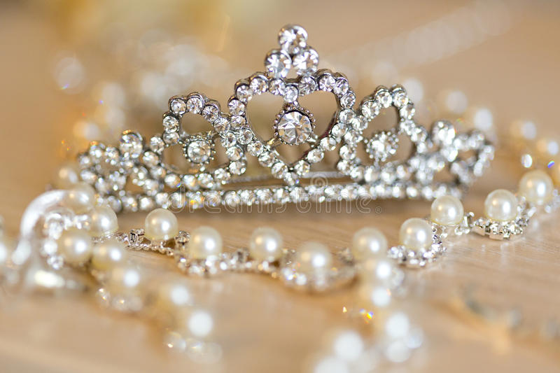 Silver diadem, tiara with rhinestones and necklace royalty free stock images
