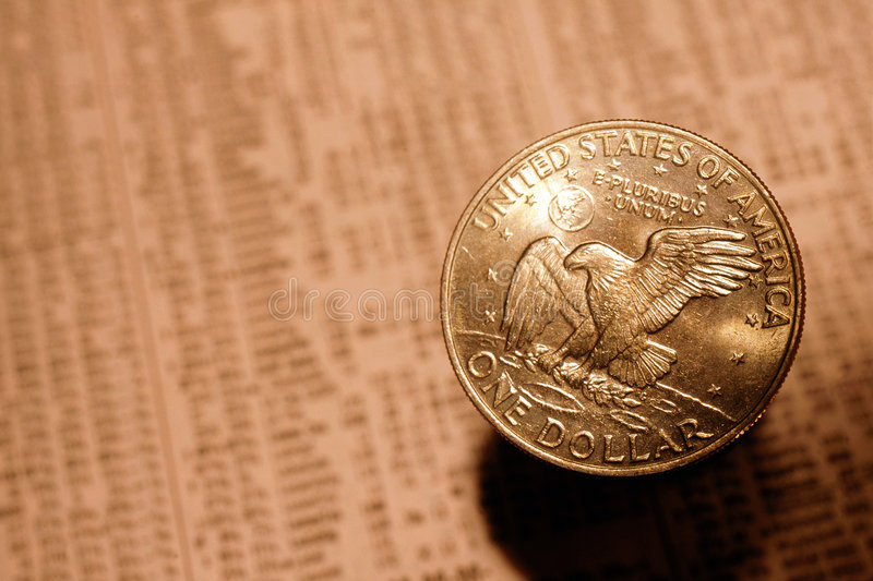 Silver Dollar. And stock market listings - symbols of the economy royalty free stock image
