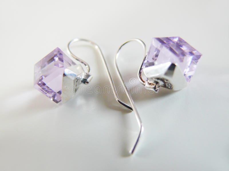 Silver Earrings With Lila Crystal Royalty Free Stock Photos