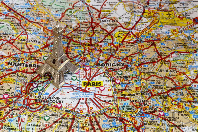 Silver Eiffel tower on Paris map royalty free stock photos