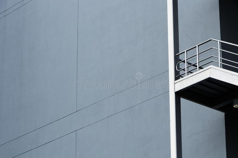 Silver emergency stairs in gray building royalty free stock photos
