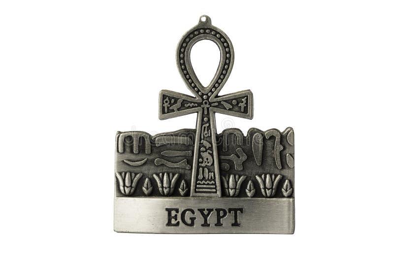 Silver färgade egyptiskt symbol av liv Ankh med Egypten etikettiso arkivfoton
