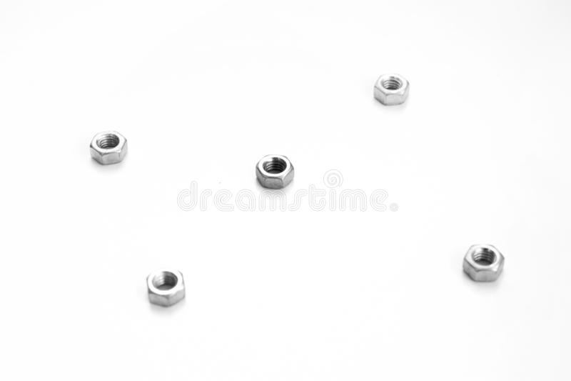 Silver f?r krom f?r arbete f?r reparation f?r konstruktion f?r skruv f?r maskinvarubultmutter vit arkivbild