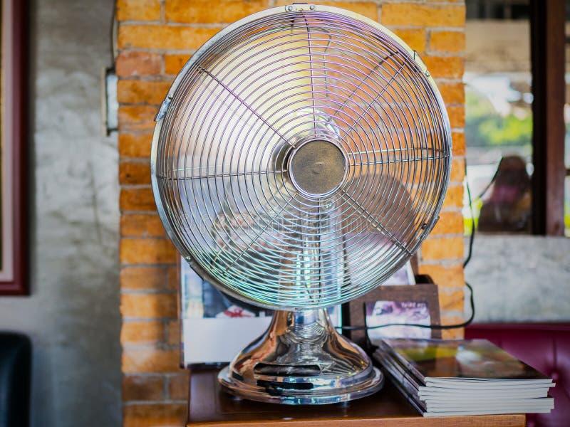 Silver fan, table vintage fan royalty free stock photos