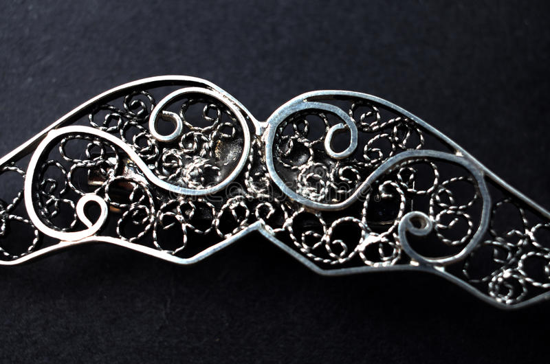Silver filigree brooch. Picture of a Silver filigree brooch,macro royalty free stock photo
