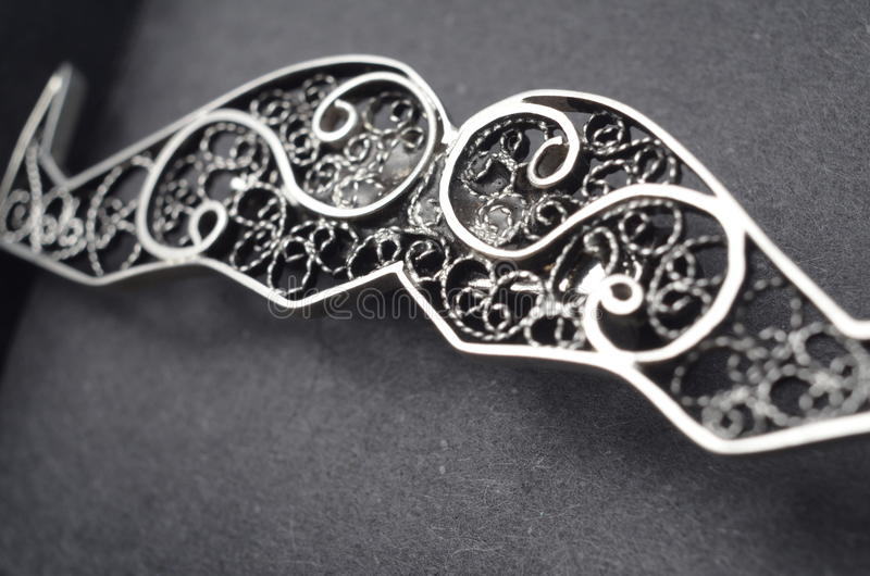 Silver filigree brooch. Picture of a Silver filigree brooch,macro stock images