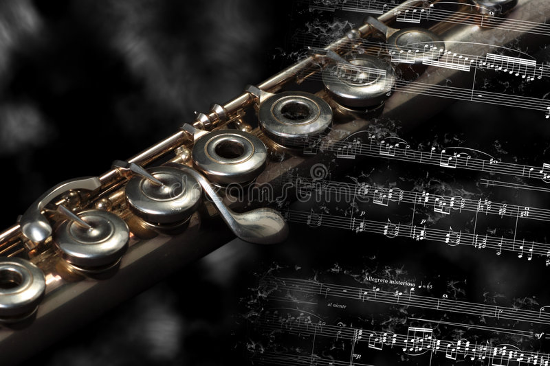 Silver Flute  On A Music Score Royalty Free Stock Images