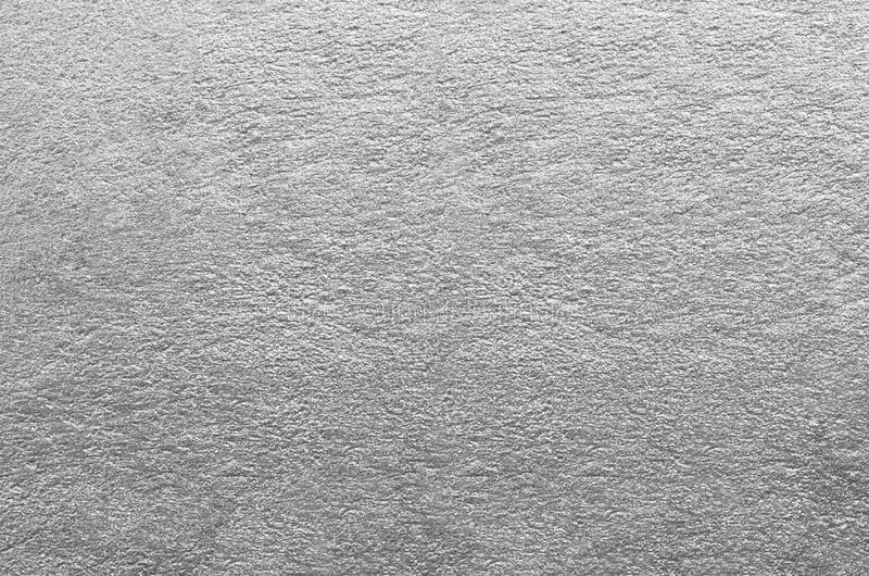 Silver foil texture. Rough paper. Abstract background royalty free stock photo