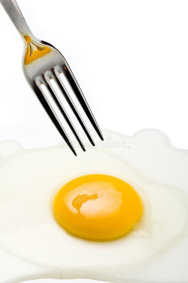 Silver Fork Pricking Broken Egg royalty free stock photography