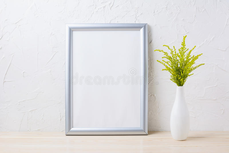 Silver frame mockup with ornamental grass in exquisite vase stock photography