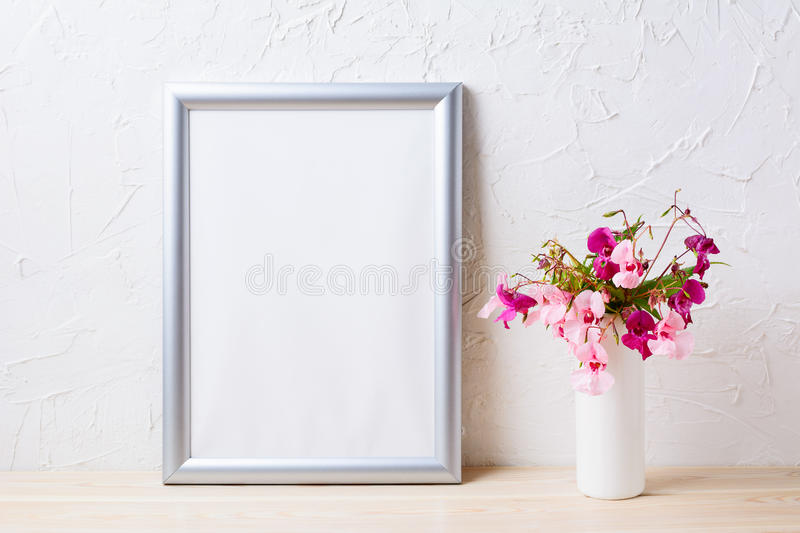 Silver frame mockup with pink and purple flower bouquet royalty free stock images
