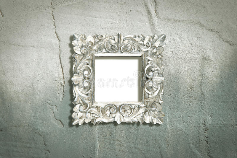Silver frame on rough wall