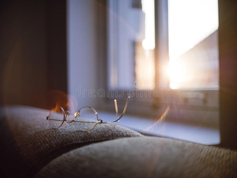 Silver Framed Eyeglasses On Brown Padded Couch Near White Wooden Window Pane In Selective Focus Photography Free Public Domain Cc0 Image